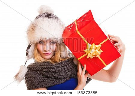 Christmas holidays valentine's day celebration and happy people concept - blonde girl in winter fur hat with red gift box present isolated