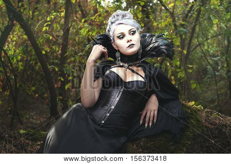 Beautiful woman a witch in the dark forest.