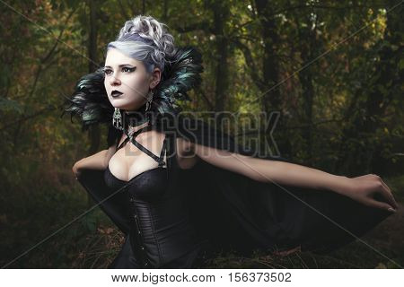 Woman causeth horror and fear she in a black dress.