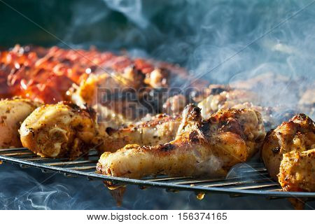 Sausage and Chicken in barbecue on hot grill