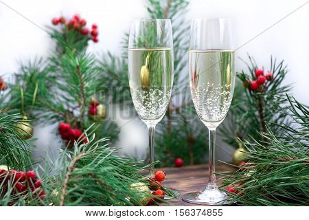 Christmas Holiday Still Life With Champaign, Pine Branches, Red Berries