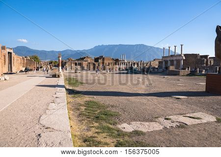 Pompeii Italy - August 29 2016: Tourists visit Popmeii town centre the ancient Roman city destroyed during a catastrophic eruption of the volcano Mount Vesuvius in 79 AD
