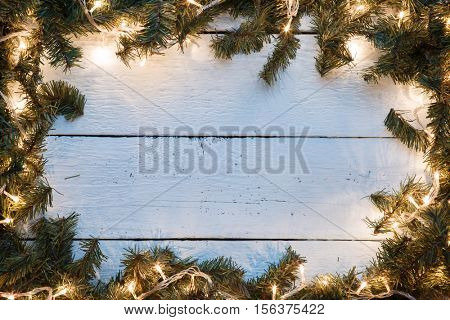 Christmas empty card with blue wooden texture illuminated light bulbs