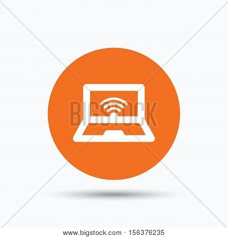 Computer with wifi icon. Notebook or laptop pc symbol. Orange circle button with flat web icon. Vector