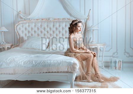 Queen sitting on the bed in the bedroom.