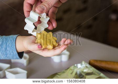 shortcrust dough in the shape of star for children's hand