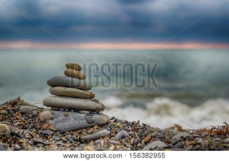 Pyramid  Smaller Stones On  Seashore Sunset