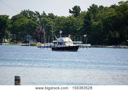 HARBOR POINT, MICHIGAN / UNITED STATES - AUGUST 3, 2016: A boat is anchored off the shore of Harbor Point.