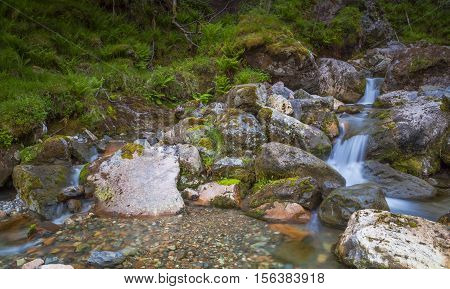 Waterfall long exposure at the hiking track to Lost Valley Glencoe Scotland