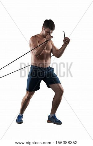 Strong athlete making exercises with wisp isolated on white background