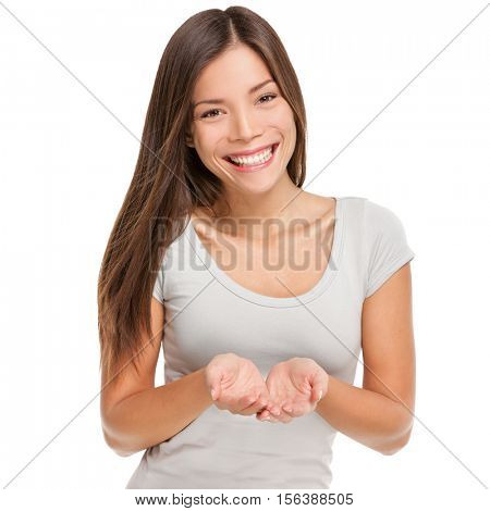 Cupped hands cupping concept. Smiling Asian woman studio portrait isolated on white background showing something on the palms of her open two hands holding for object copy space.