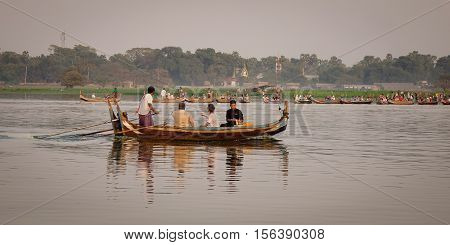 Wooden Boat Carrying Tourists On The Lake