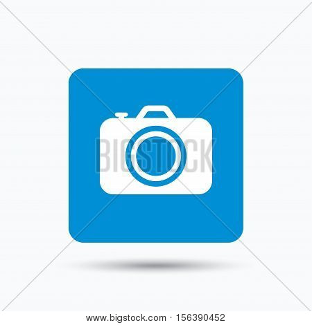 Camera icon. Professional photocamera symbol. Blue square button with flat web icon. Vector