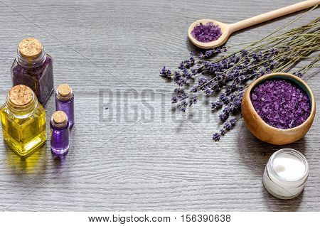 cosmetic creams with lavender flowers on black wooden table top view