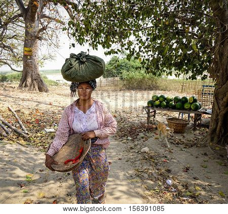 Burmese Woman On Street