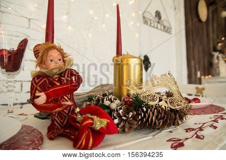 On The Festive Table Cones, Candles And Doll