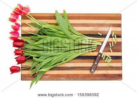 Trimming The Stems Of A Bunch Of Red Tulips
