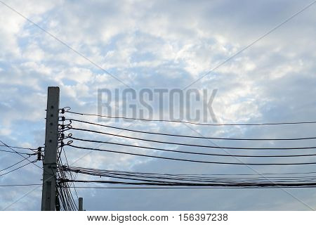 electricity pole with electricity wire in blue sky