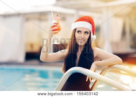 Flirty Christmas Woman with Cocktail at the Pool