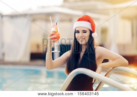 Happy Christmas Woman with Cocktail at the Pool