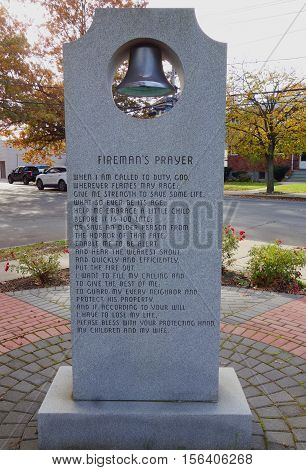 EAST ROCKAWAY, NEW YORK - NOVEMBER 10, 2016: Fireman's prayer at Firefighters memorial in East Rockaway, New York