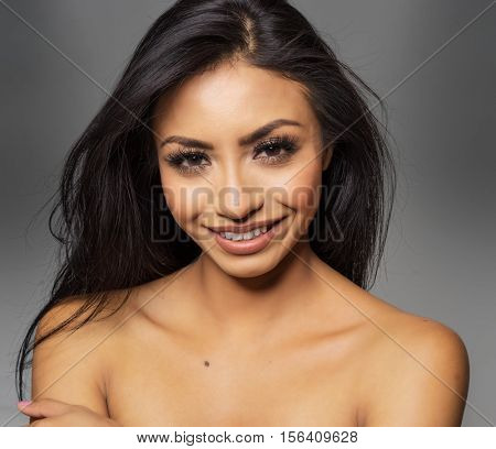 Beautiful woman with glowing skin and happy smile