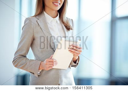 Female white collar worker holding a digital tablet