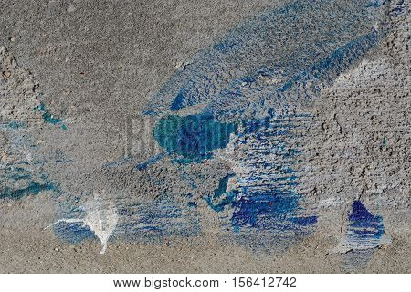 Abstract design with texture from spilled paint on concrete after repainting job