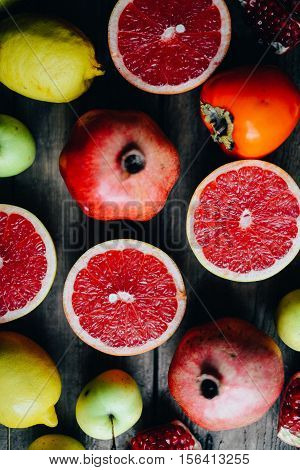 Different Fresh Citrus Fruit In A Basket On A  Wooden Background