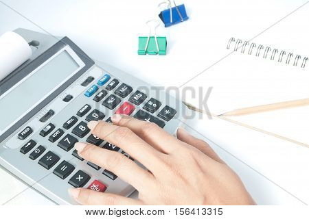 Accounting concept with woman's hand, accounting concept