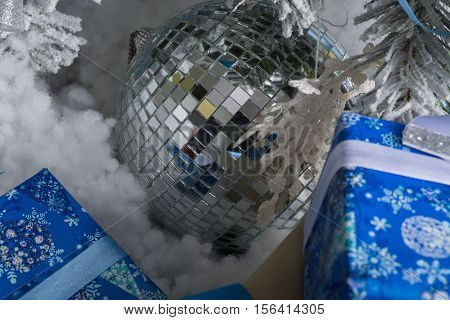 New Year's photo. the New Year's tree with imitation of snow is decorated with toys. Gifts lie under a fNew Year's tree.