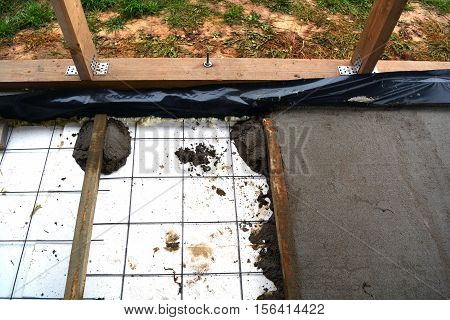 Insulating farm house floor with polystyrene and concrete