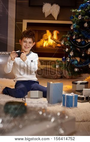 Little boy happy for mobilephone at christmas time.