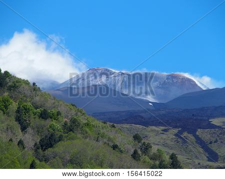 Fuming Mount Etna in summer, the tallest active volcano in Europe, Sicily, Italy