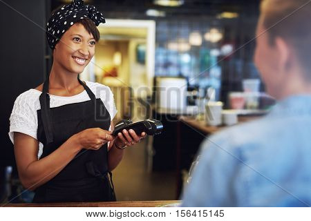 Smiling Small Business Owner Taking Payment