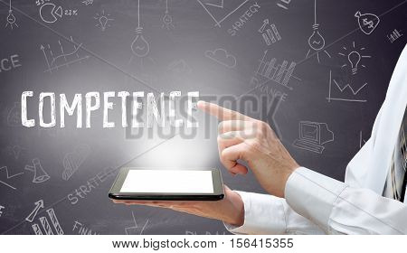 Businessman is using tablet pc and selecting competence