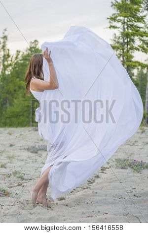 Beautiful Girl Dancing On The Beach.