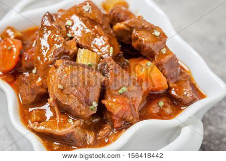 Beef stew with beer, rosemary and vegetables