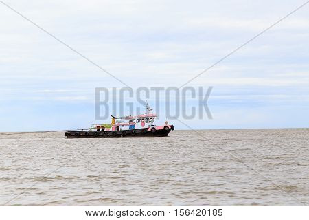 Pink Tug Boat Was Towed Ship
