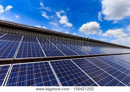 Solar cell on roof top against blue sunny sky., alternative energy