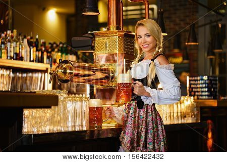 Smiling waitress with beer