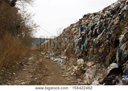Landfill in Ukraine, piles of plastic dumped in piles. The roads along inorganic waste jumble, Air, ground pollution