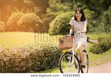 Woman smiling and freestyle in relax day. women think positive and enjoy in outdoor. Lifestyle in free day no activity and no work. enjoy in life for health in the nature or outdoor or garden.
