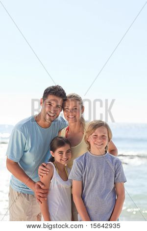 Joyful family at the beach