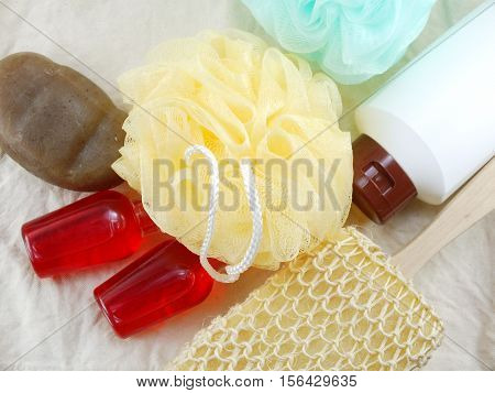 Shampoo And Liquid Shower Gel With Bath Puff And Loofah Spa Kit Top View