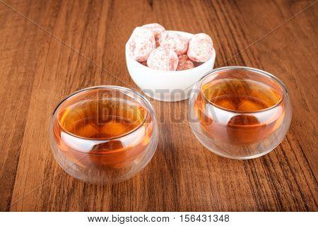 Tea In Cups And Kumquat