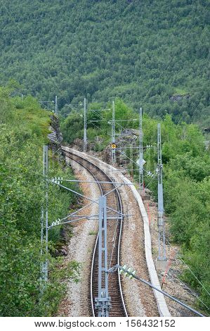 Single track Mountain Railway in forest  Flam Norway