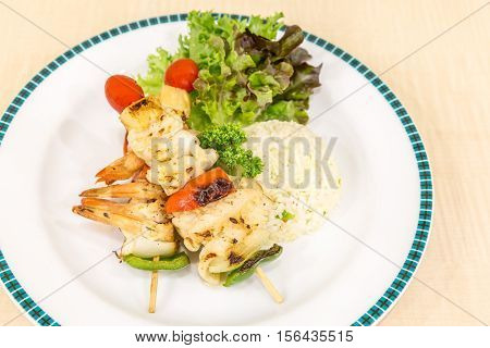 grilled seafood skewer with fried rice