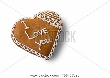Brown heart shaped cookie. Biscuit with inscription. The most important words. Little present for beloved one.