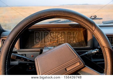 On-board panel of the 90's car in the light of sunset